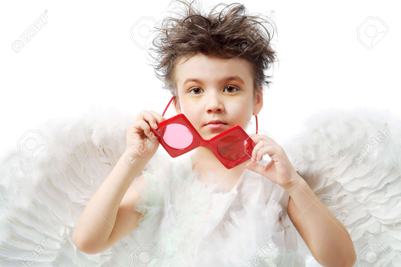 Beautiful little angel at a white background. Stock Photo - 6098573