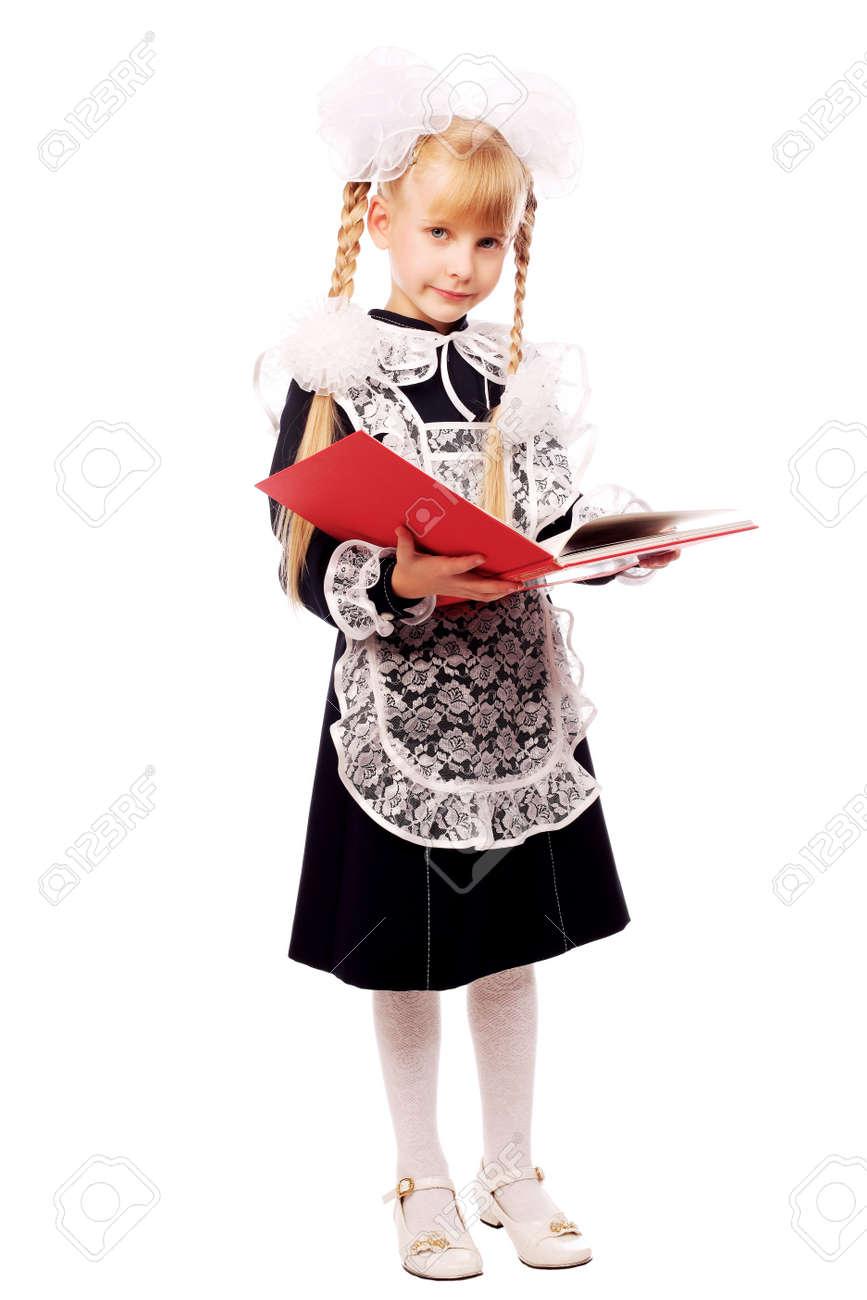 Portrait of a schoolgirl in uniform reading her book. Stock Photo - 6118563