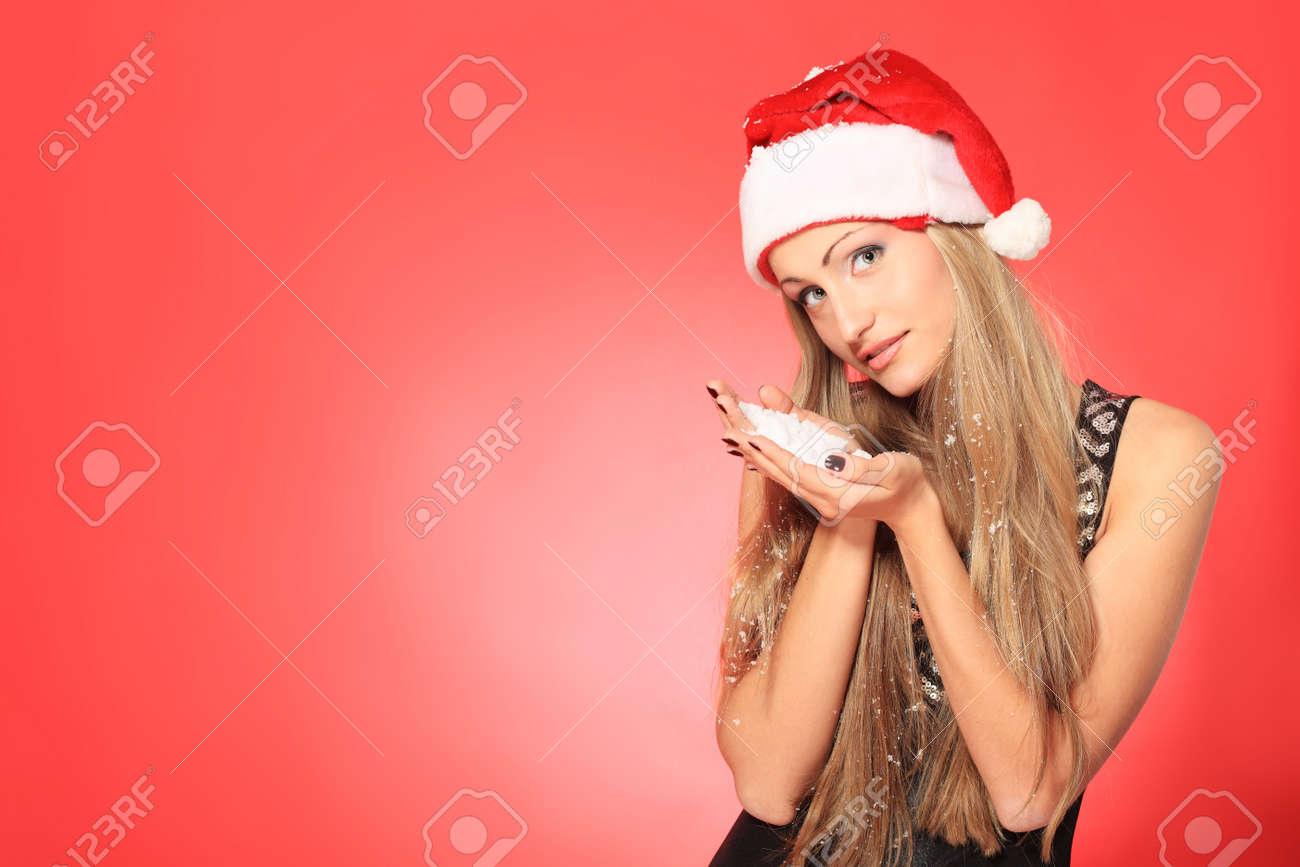 Portrait of a beautiful young woman wearing christmas clothes over red background. Stock Photo - 6129988