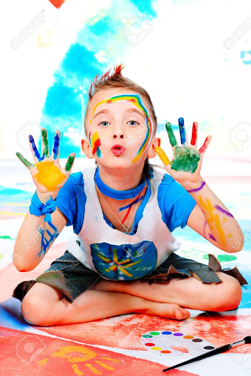 Portrait of a beautiful child enjoying his painting. Education. Stock Photo - 6191558