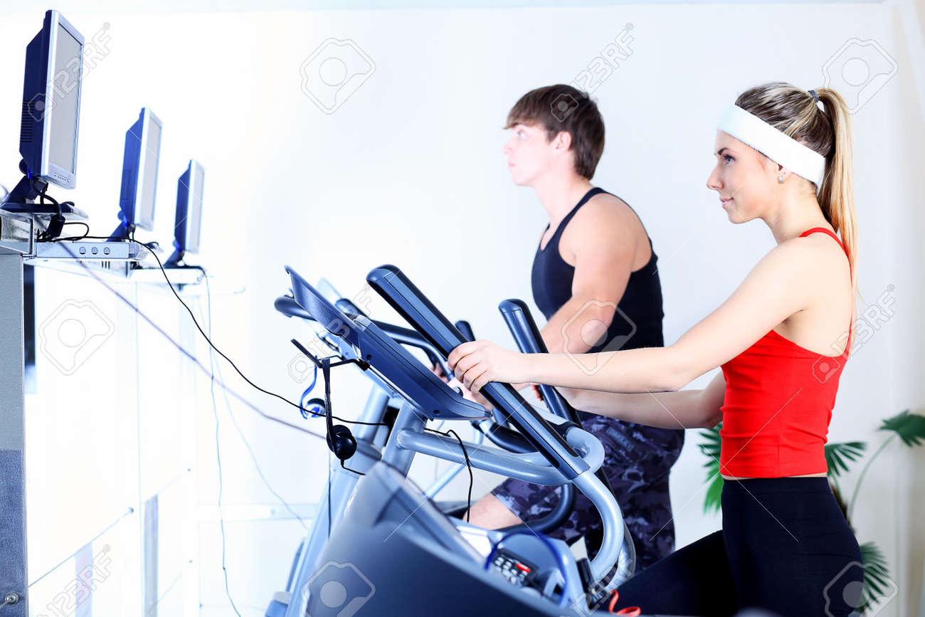 Couple of a sporty young people in the gym. Stock Photo - 6247791