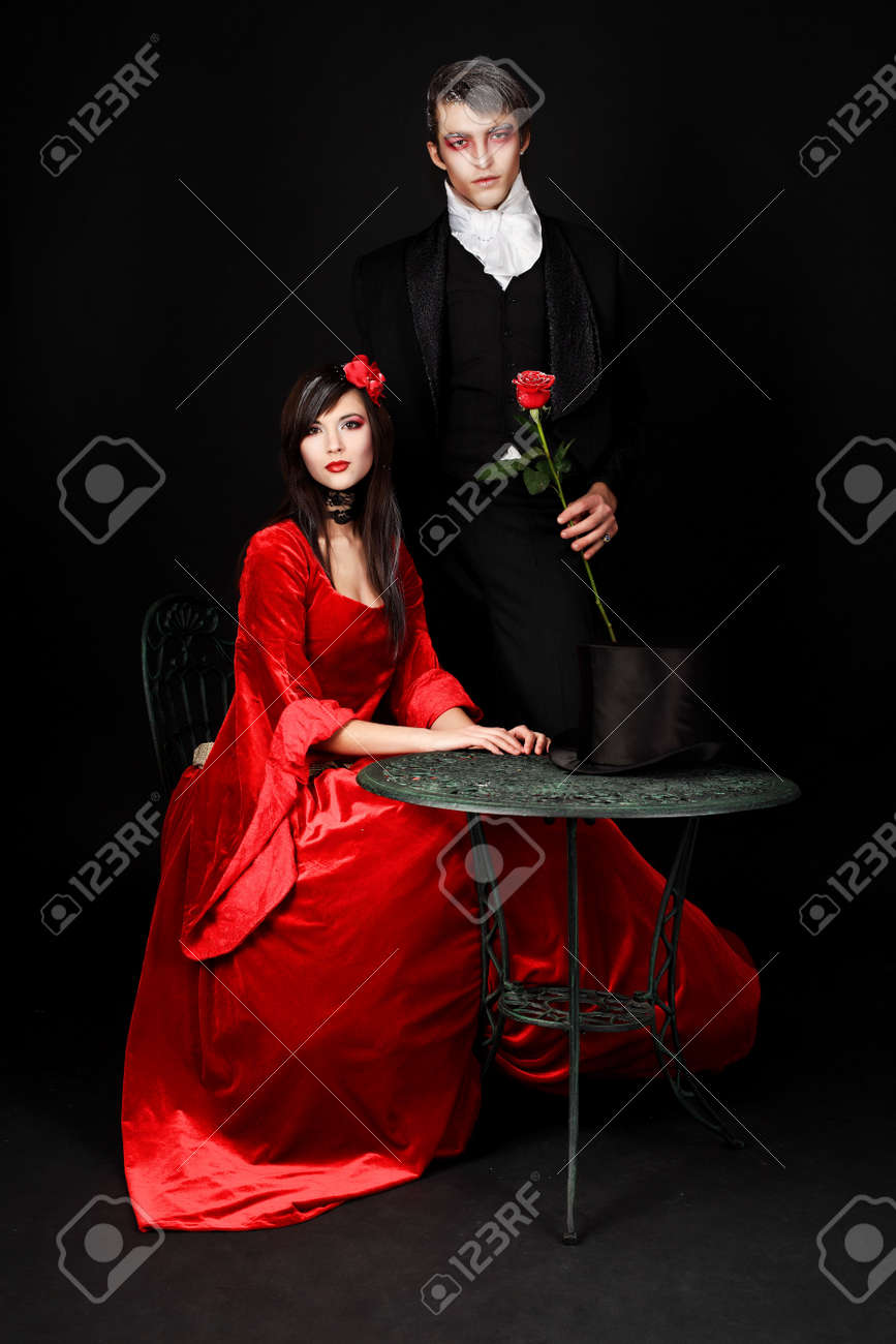Portrait of a beautiful couple in medieval costumes with vampire style make-up. Shot in a studio. Stock Photo - 6353091