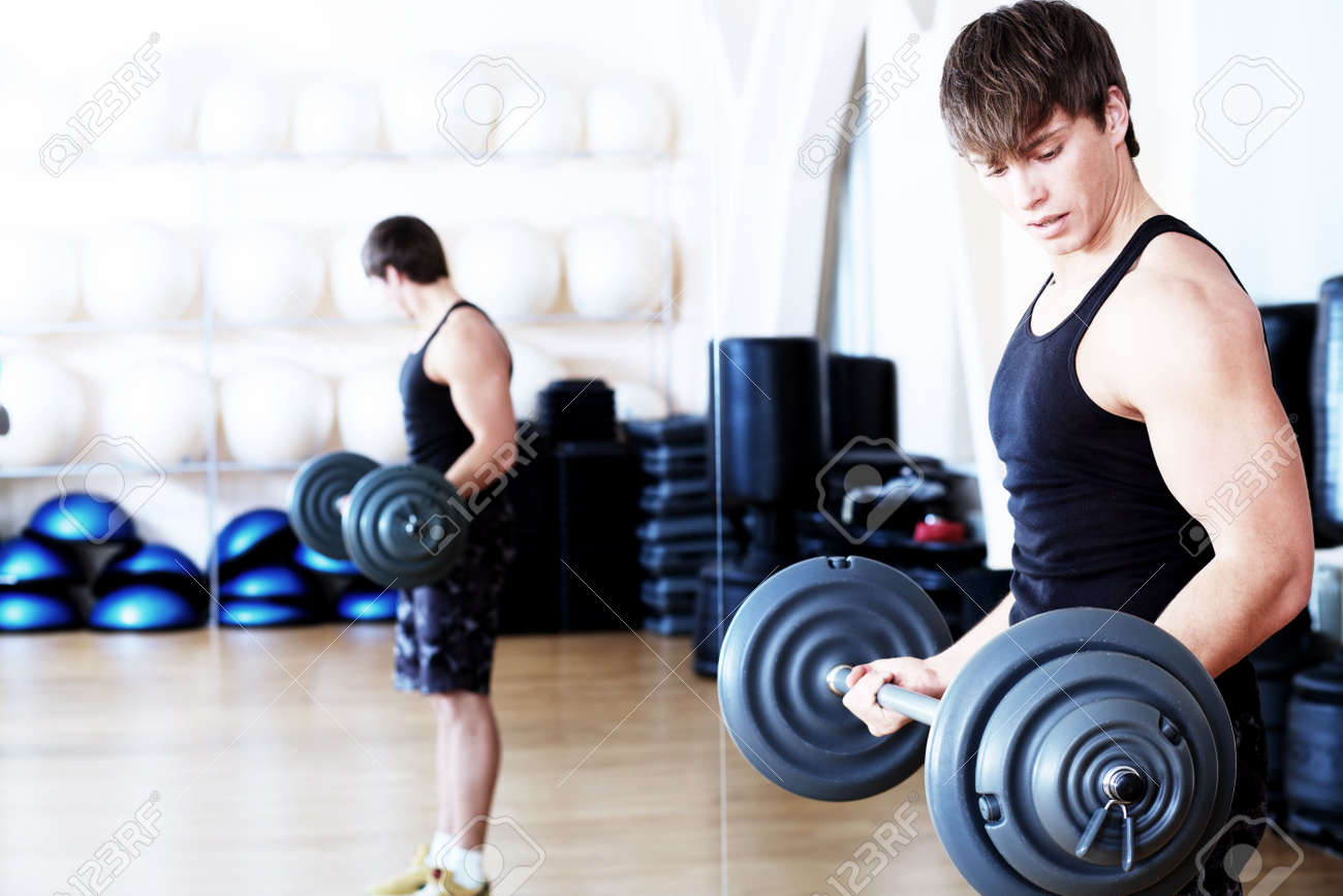 Sporty man in the gym centre. Stock Photo - 6353242
