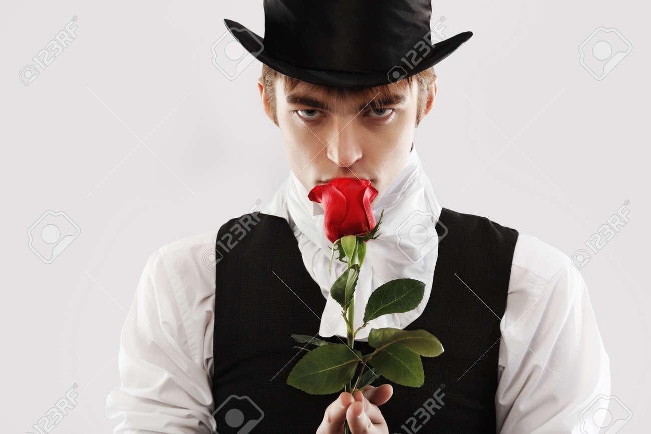 Portrait of a young gentlemen wearing dinner jacket and black top hat. Shot in a studio. Stock Photo - 6386129