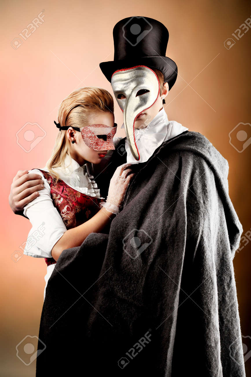 f8eff4cc5172c Portrait of the elegant young couple in masquerade costumes. Shot in a  studio. Stock