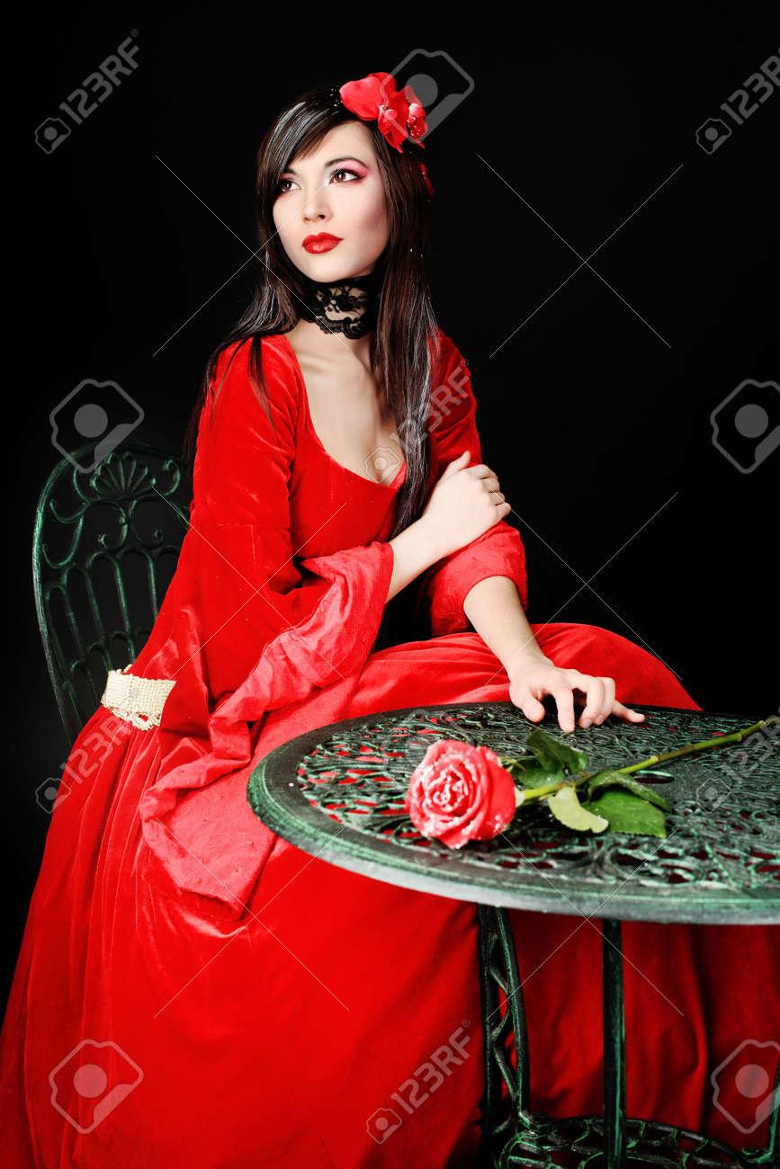 Portrait of a beautiful woman in medieval era dress. Shot in a studio. Stock Photo - 6616164