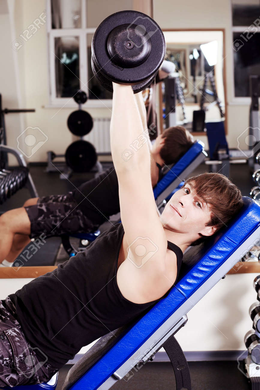 Sporty man in the gym centre. Stock Photo - 11692175