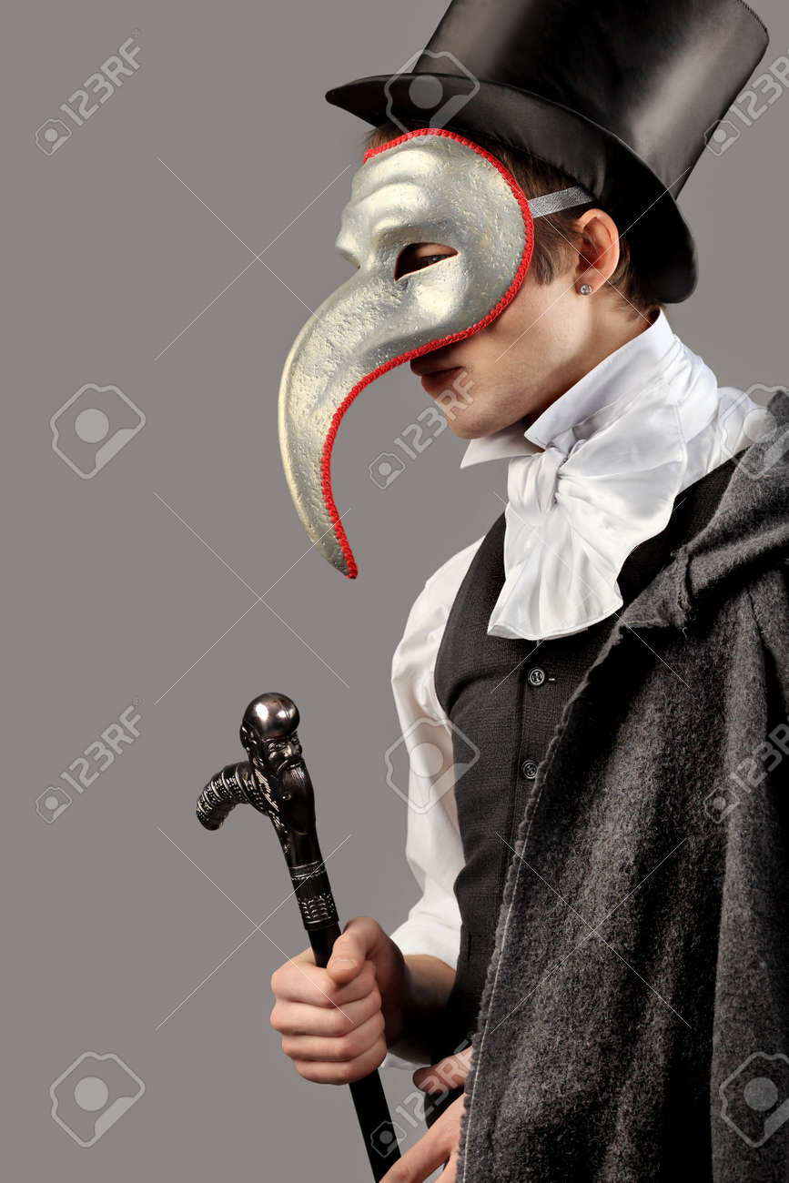 Portrait of a young gentlemen wearing masquerade costume. Shot in a studio. Stock Photo - 6742237