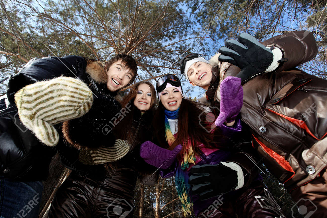 Group of young people having a rest outdoor in winter. Stock Photo - 6742265