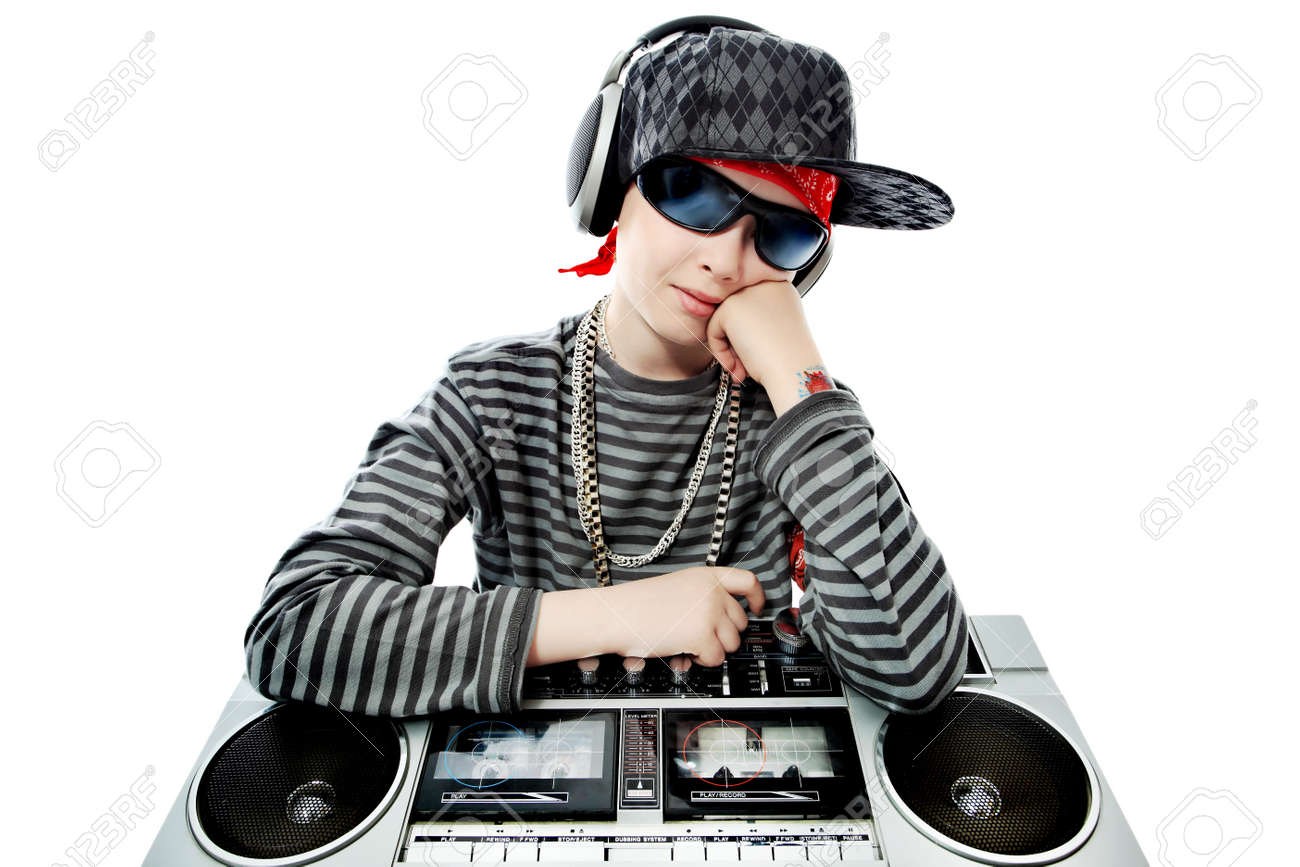 Shot of a trendy teenager listening to music in headphones. Isolated over white background. Stock Photo - 11340215