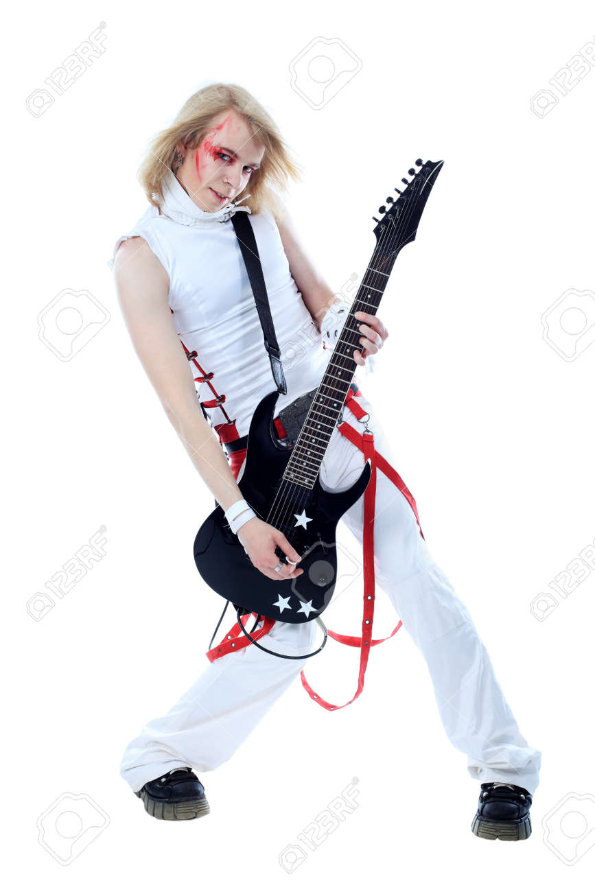 Rock musician is playing electrical guitar. Shot in a studio. Stock Photo - 7268794