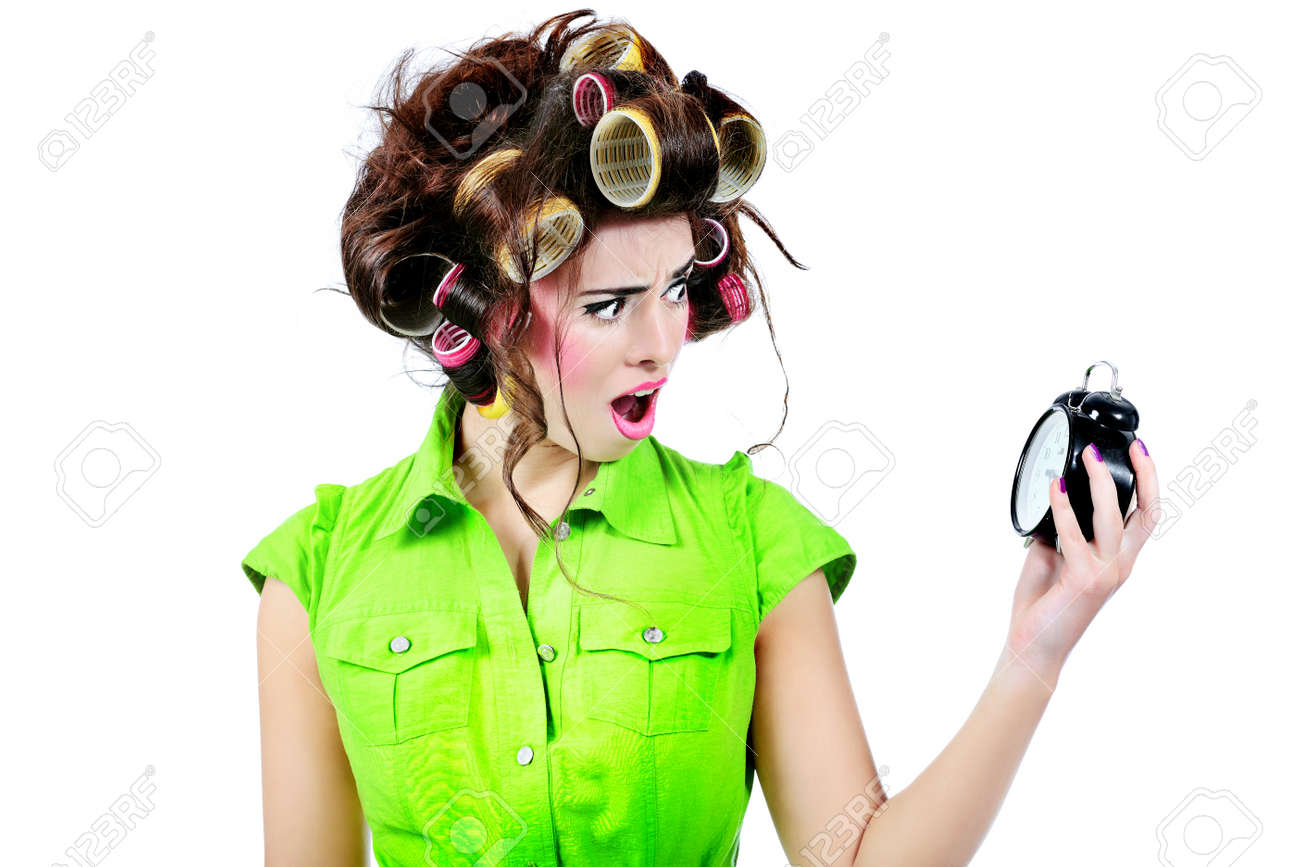 Shot of a funny woman housewife dressed in retro style. Stock Photo - 7462772