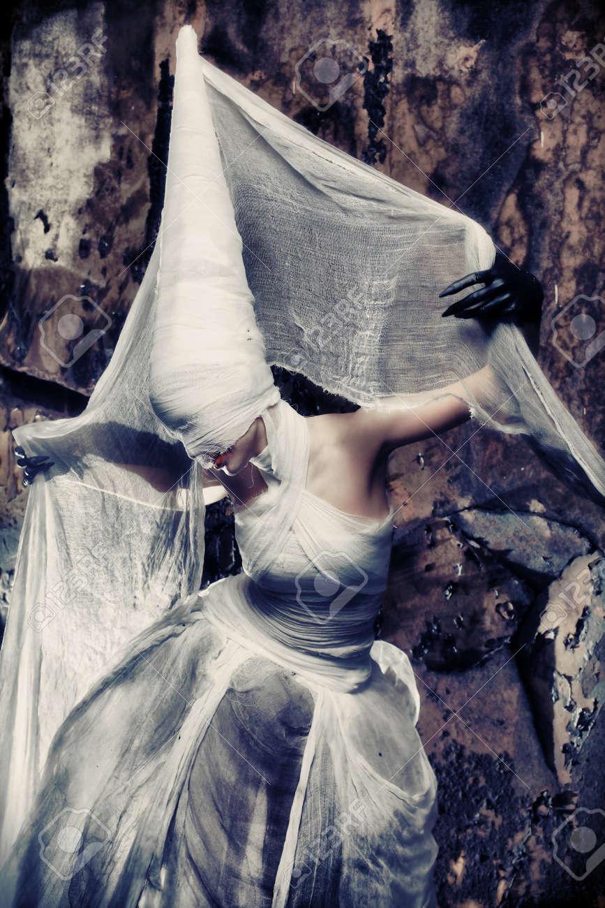Shot of a twilight girl in white dress. Halloween, horror. Stock Photo - 7498961