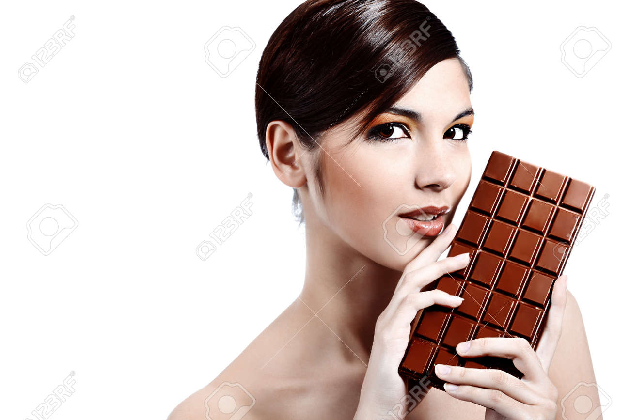 Shot Of A Beautiful Young Woman Holding Big Chocolate Bar. Stock ...