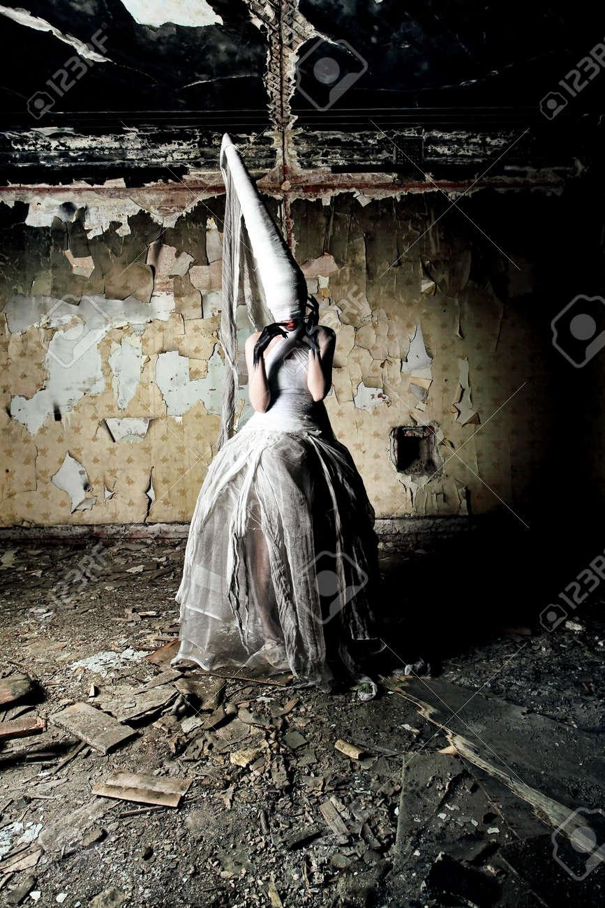 Shot of a twilight girl in white dress. Halloween, horror. Stock Photo - 7552240