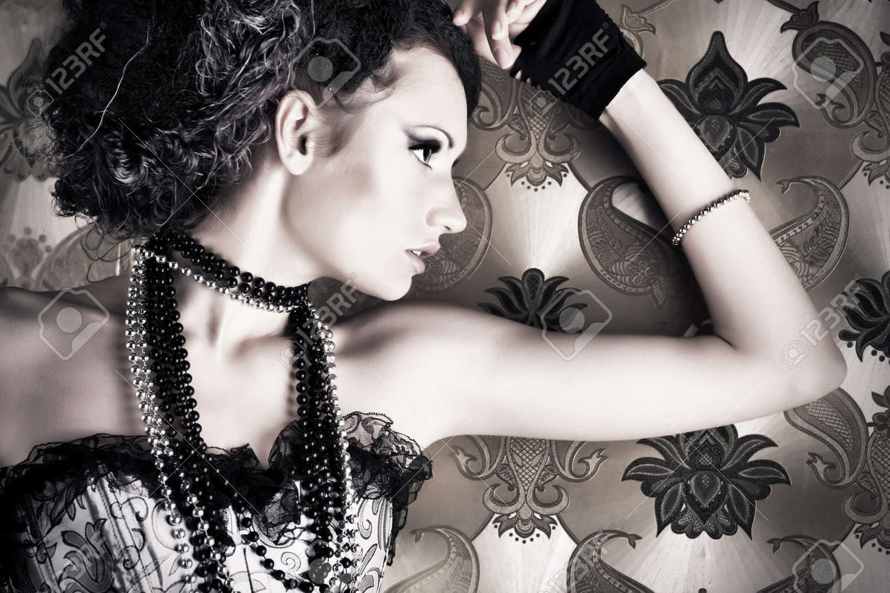 Beautiful fashionable woman over vintage background. Stock Photo - 7647571