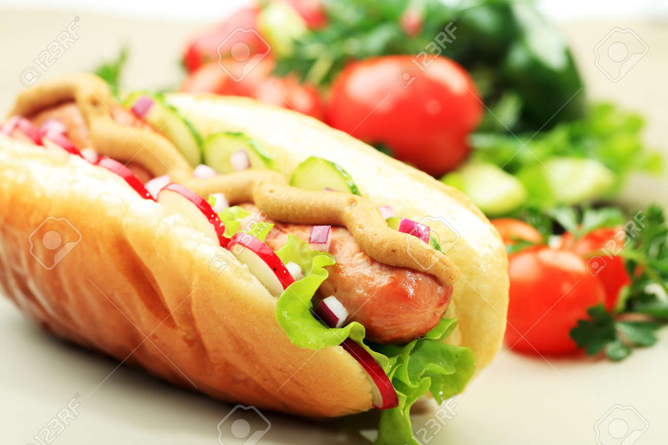 Close up of hot dog. Fast food. Isolated over white background. - 7702564