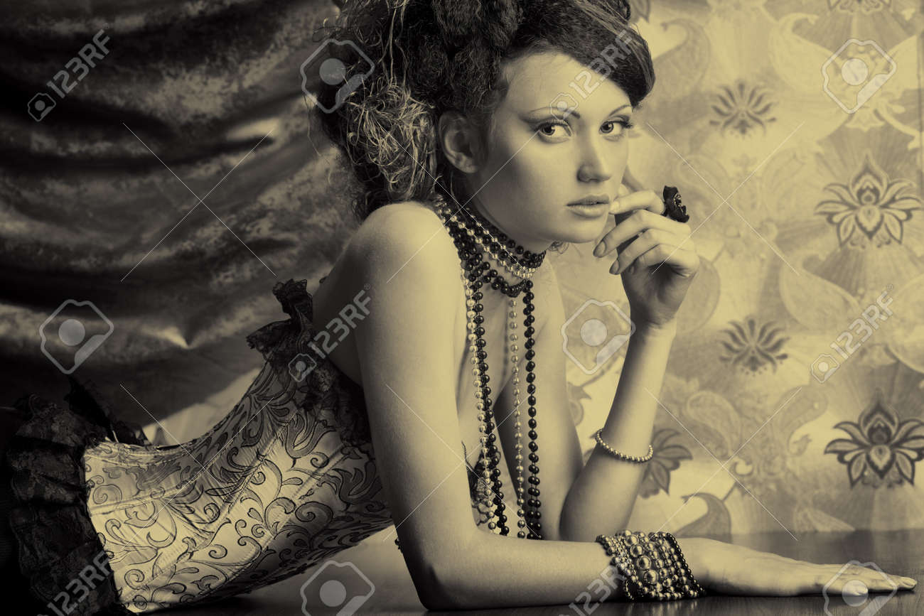 Beautiful fashionable woman over vintage background. Stock Photo - 7803235