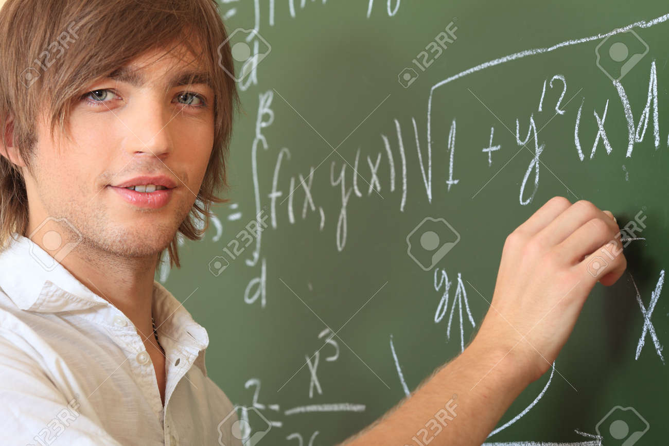 Educational theme: male student in a classroom. Stock Photo - 7907117