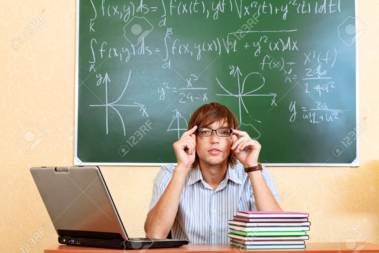 Educational theme: male student in a classroom. Stock Photo - 8160153