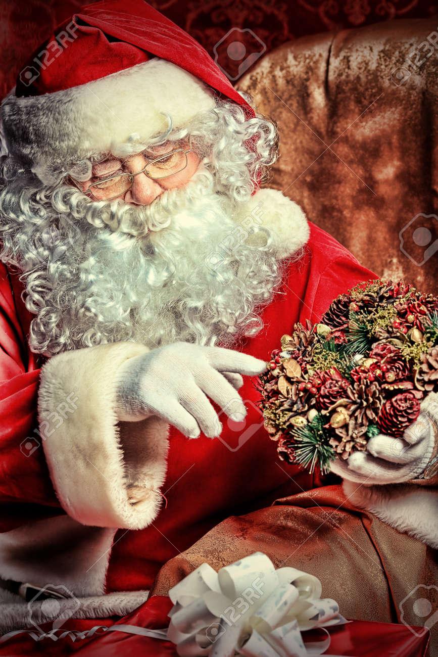 Christmas theme: Santa gifts, ina a interior. Stock Photo - 8217315