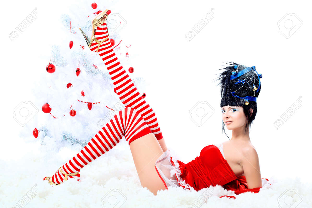 Beautiful young woman in Santa Claus clothes isolated over white background. Christmas. Stock Photo - 8312928