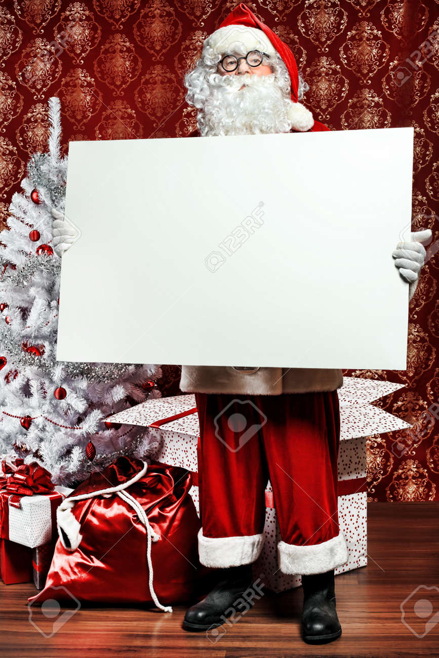 Portrait of Santa Claus holding white board. Christmas. Stock Photo - 8313878