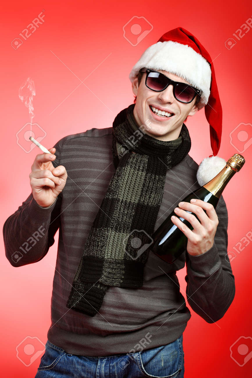 Portrait of a handsome young man in Santa Claus hat celebrating Christmas. Stock Photo - 8318859