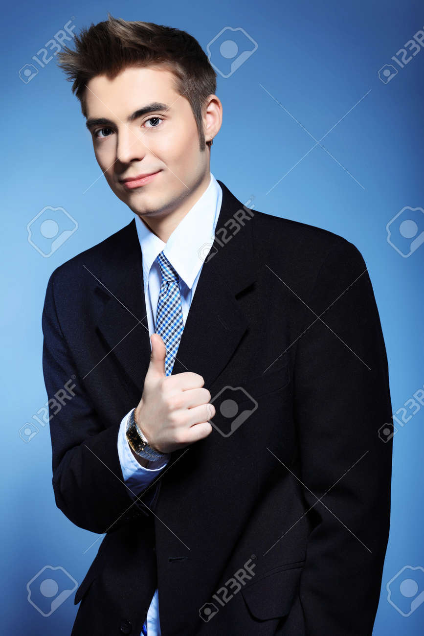 Portrait of a young businessman posing over grey background. Stock Photo - 8490933