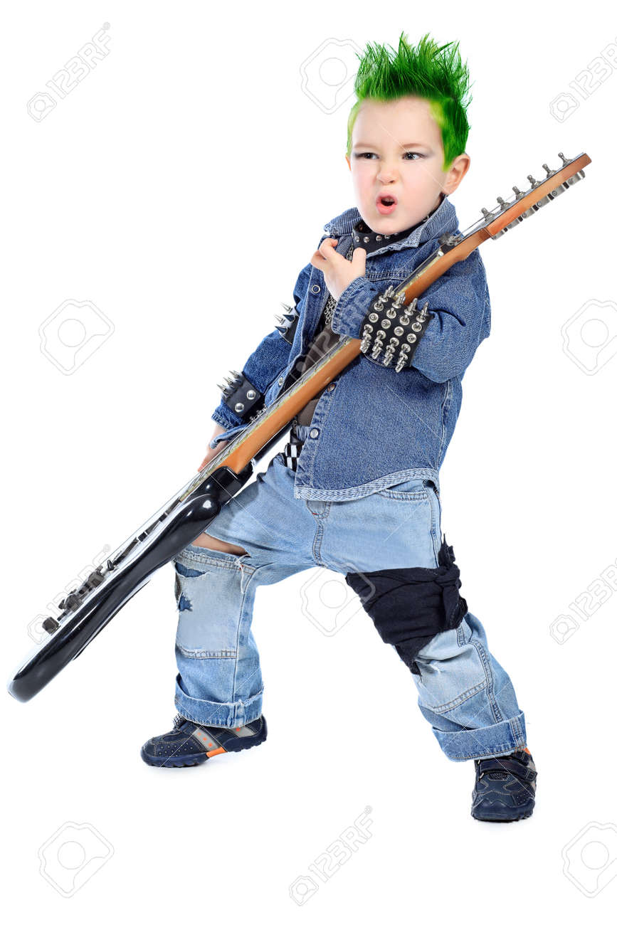 Shot of a little boy playing rock music with electric guitar. Isolated over white background. Stock Photo - 8646630