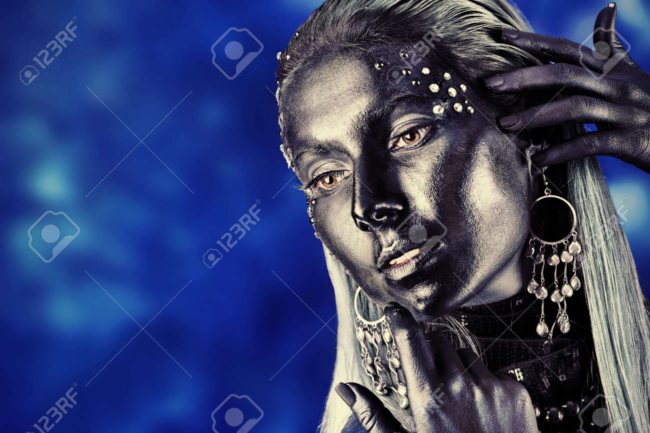 Portrait of an artistic woman painted with black color and spangled. Body painting project. Jewellery. Stock Photo - 8646666