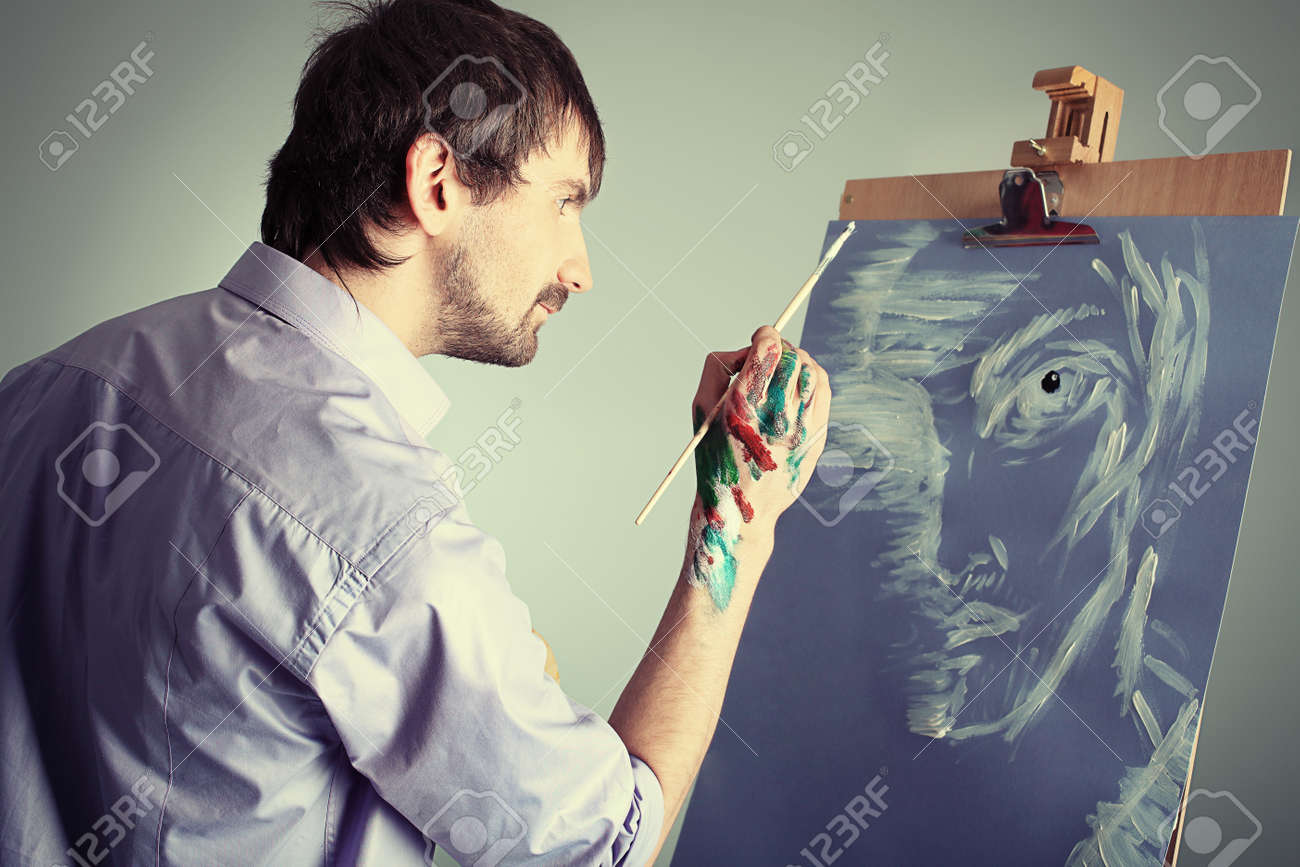 Portrait of an artist painting on easel. Shot in a studio. Stock Photo - 8714123
