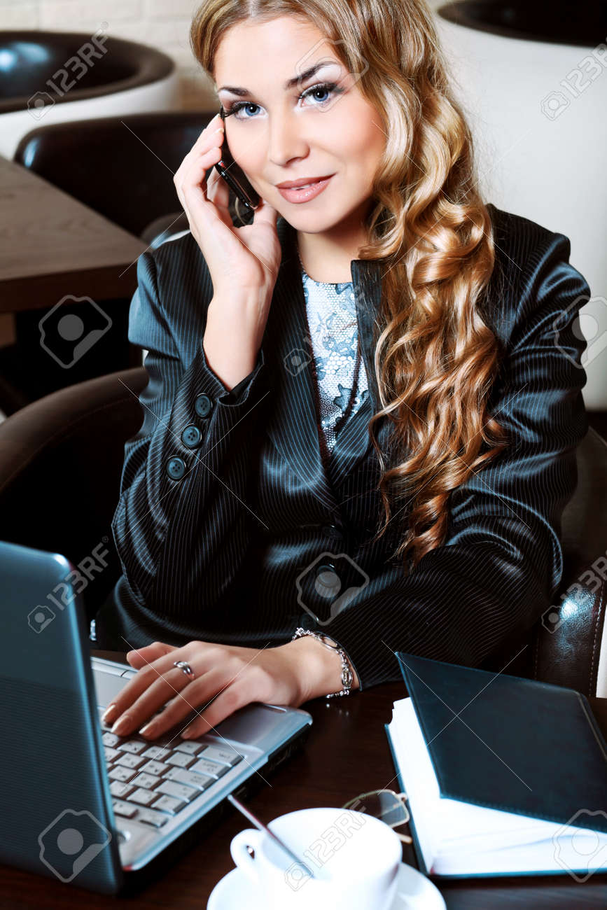 Young business woman having a break at a caf Stock Photo - 8714143