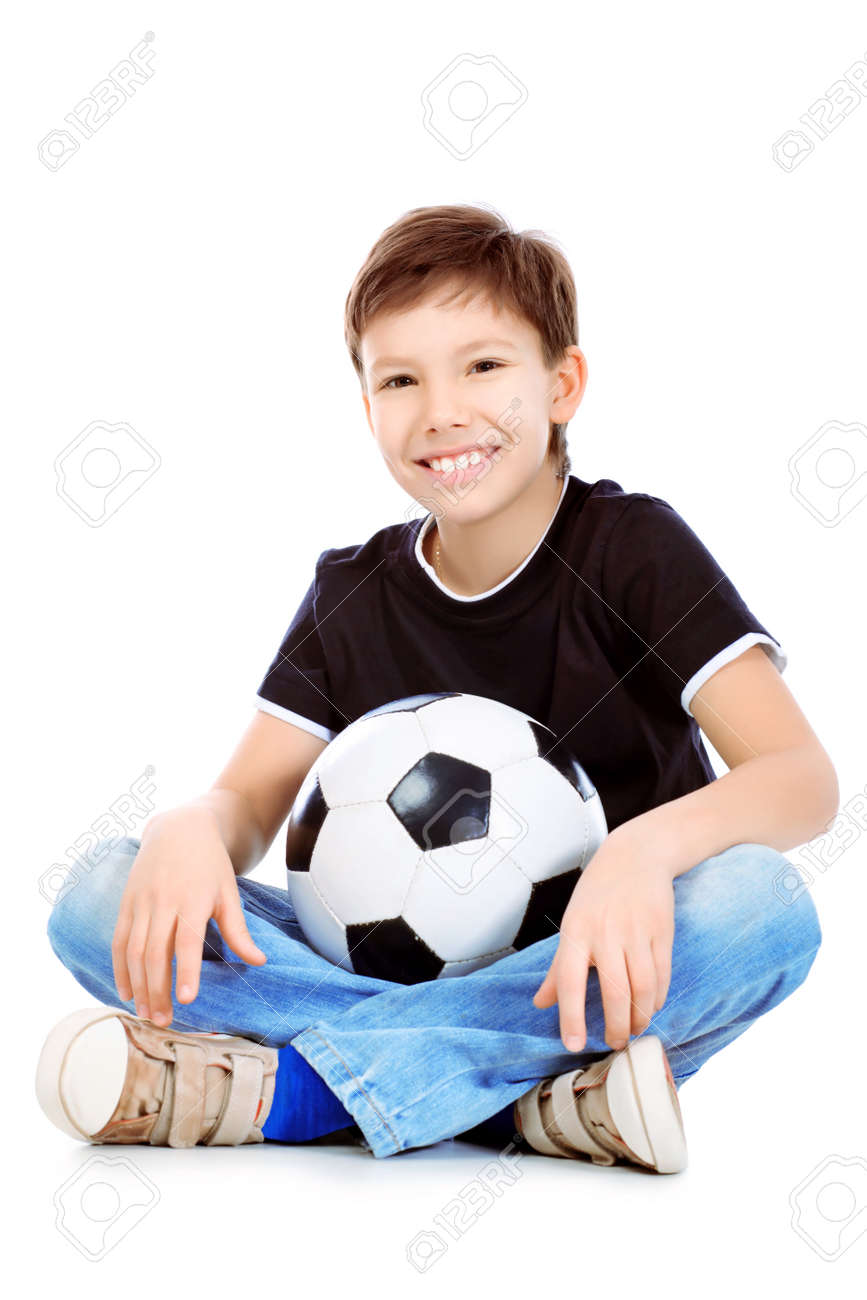 Portrait of a boy with a ball. Isolated over white background. Stock Photo - 8834973
