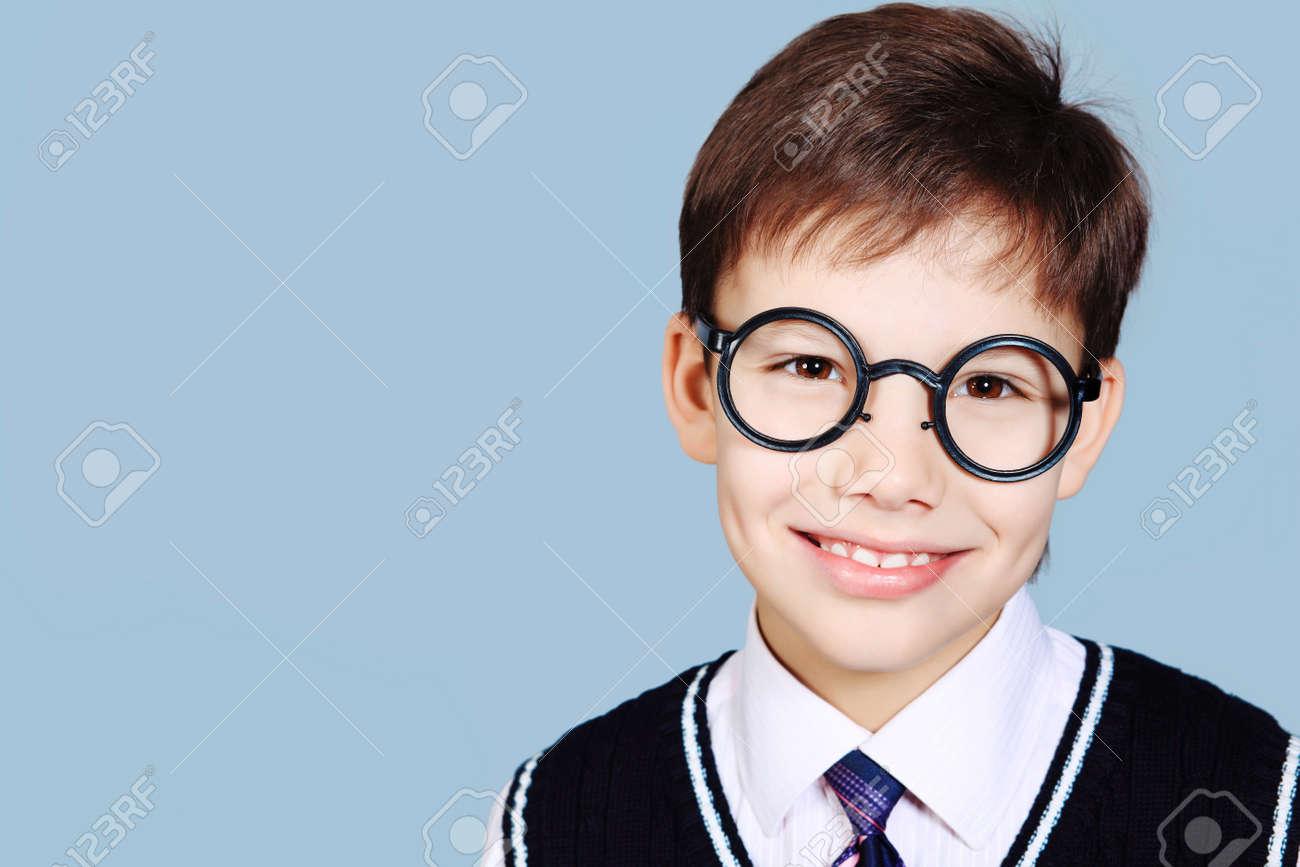 Educational theme: portrait of a schoolboy. Studio shot over grey background. Stock Photo - 8835228