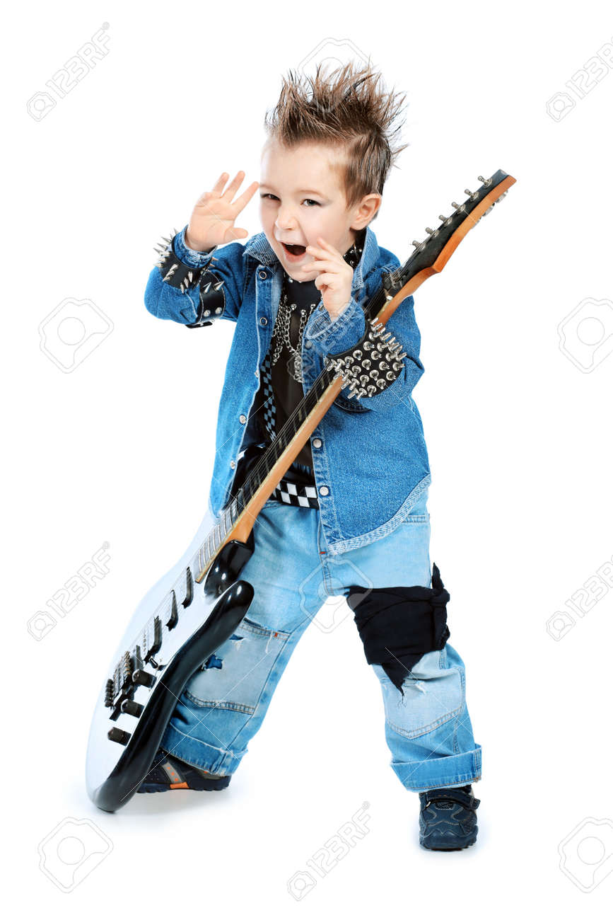 Shot of a little boy playing rock music with electric guitar. Isolated over white background. Stock Photo - 8935198