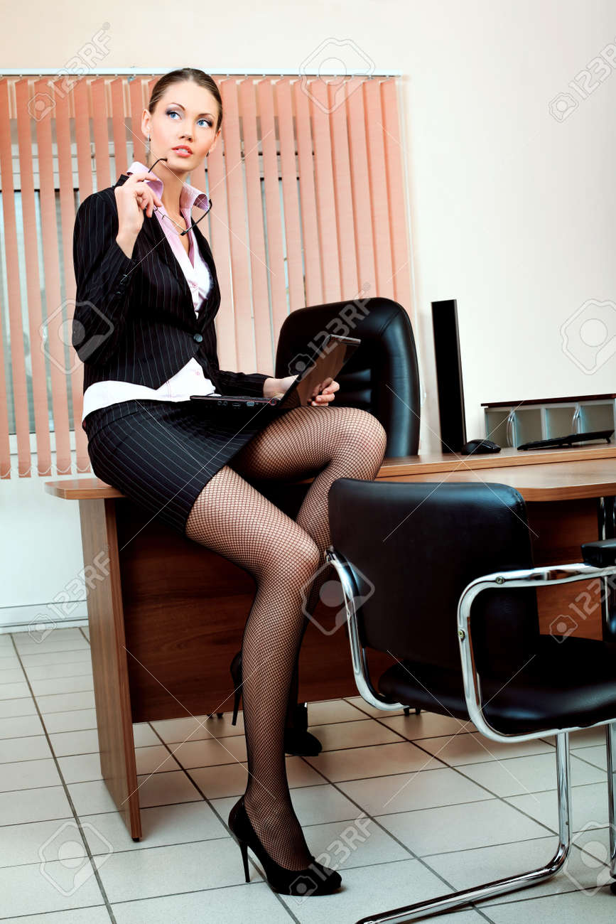 Attractive business woman is working at the office. Stock Photo - 9072402