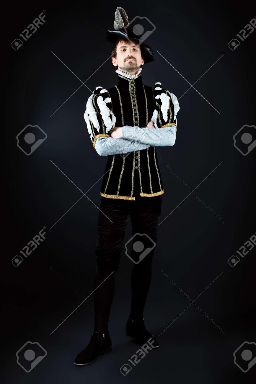 Portrait of a handsome man grandee in 16th century costume. Shot in a studio. - 9184124