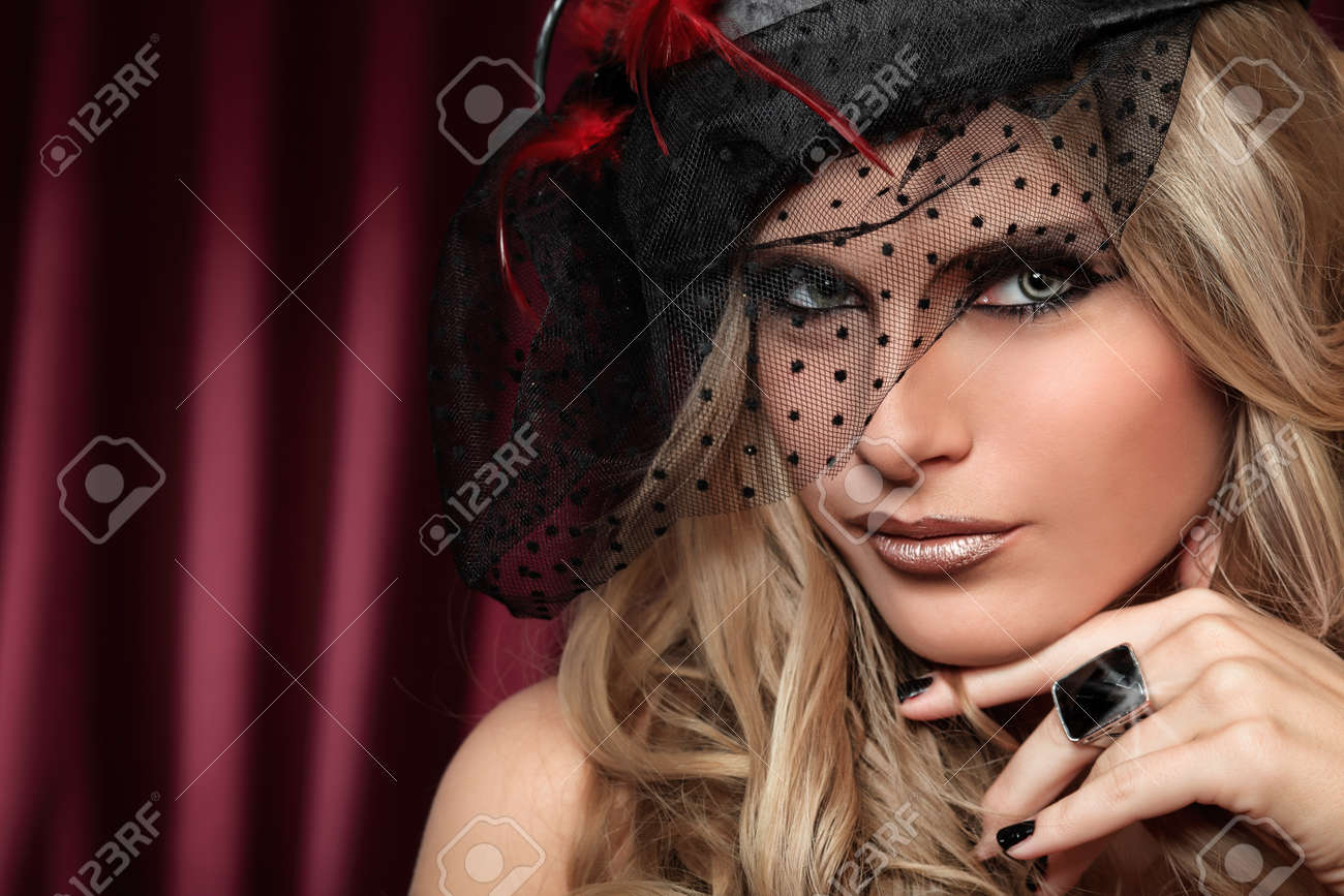 Portrait of a sexy beautiful woman over vintage background. Stock Photo - 9296921