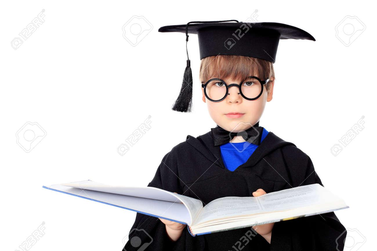 Cute little boy in graduation gown Stock Photo - 9454338