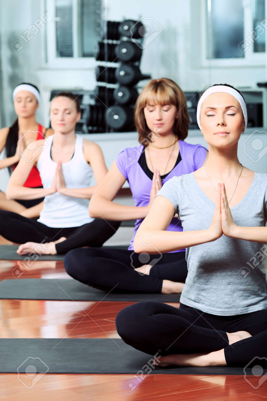 Group of young women in the gym centre. Yoga. Stock Photo - 9620563