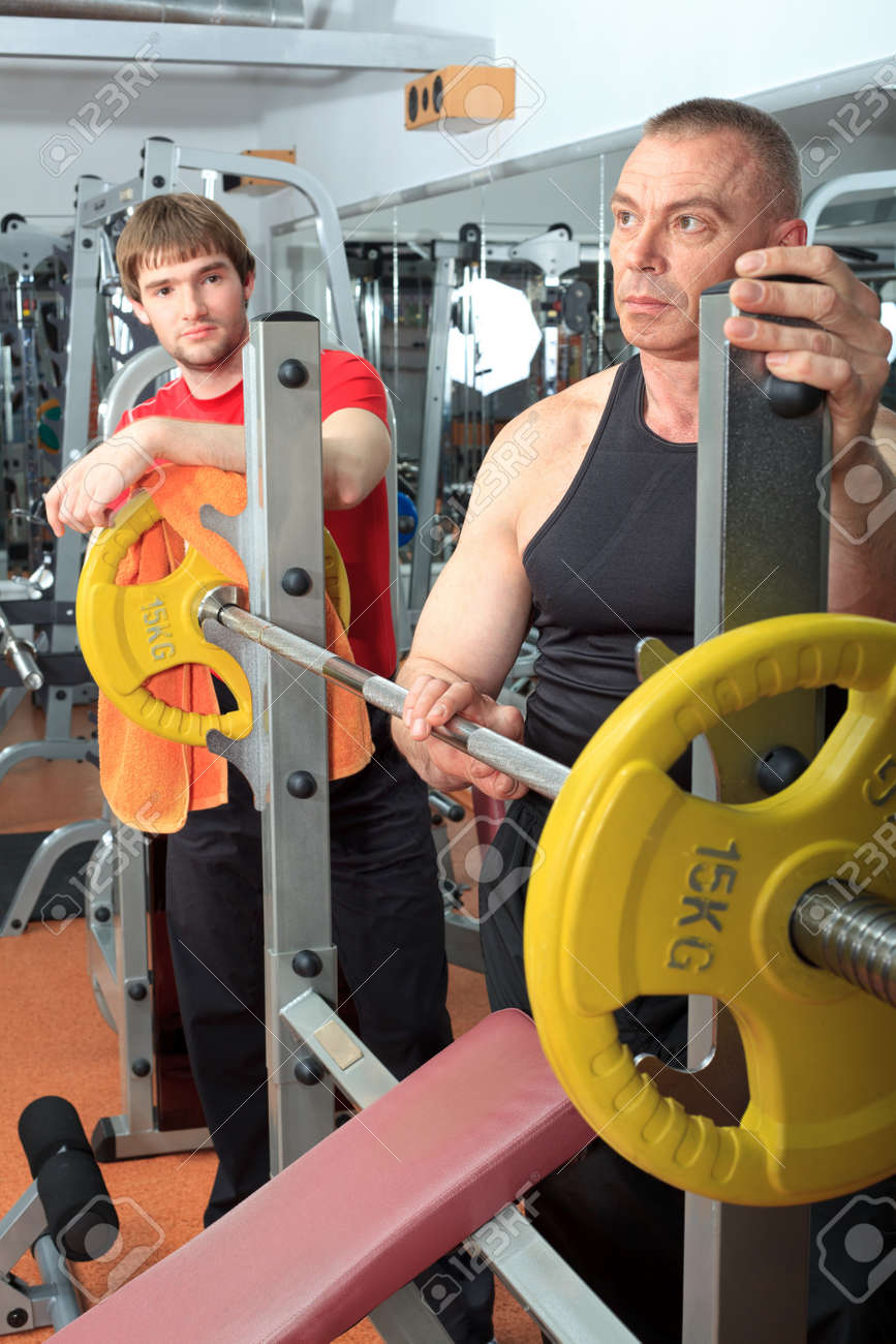 Sporty men in the gym centre. Stock Photo - 9631231