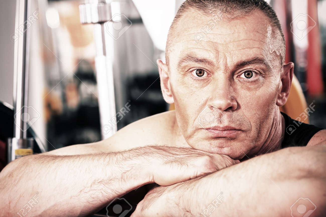 Mature sporty man in the gym centre. Stock Photo - 9631233