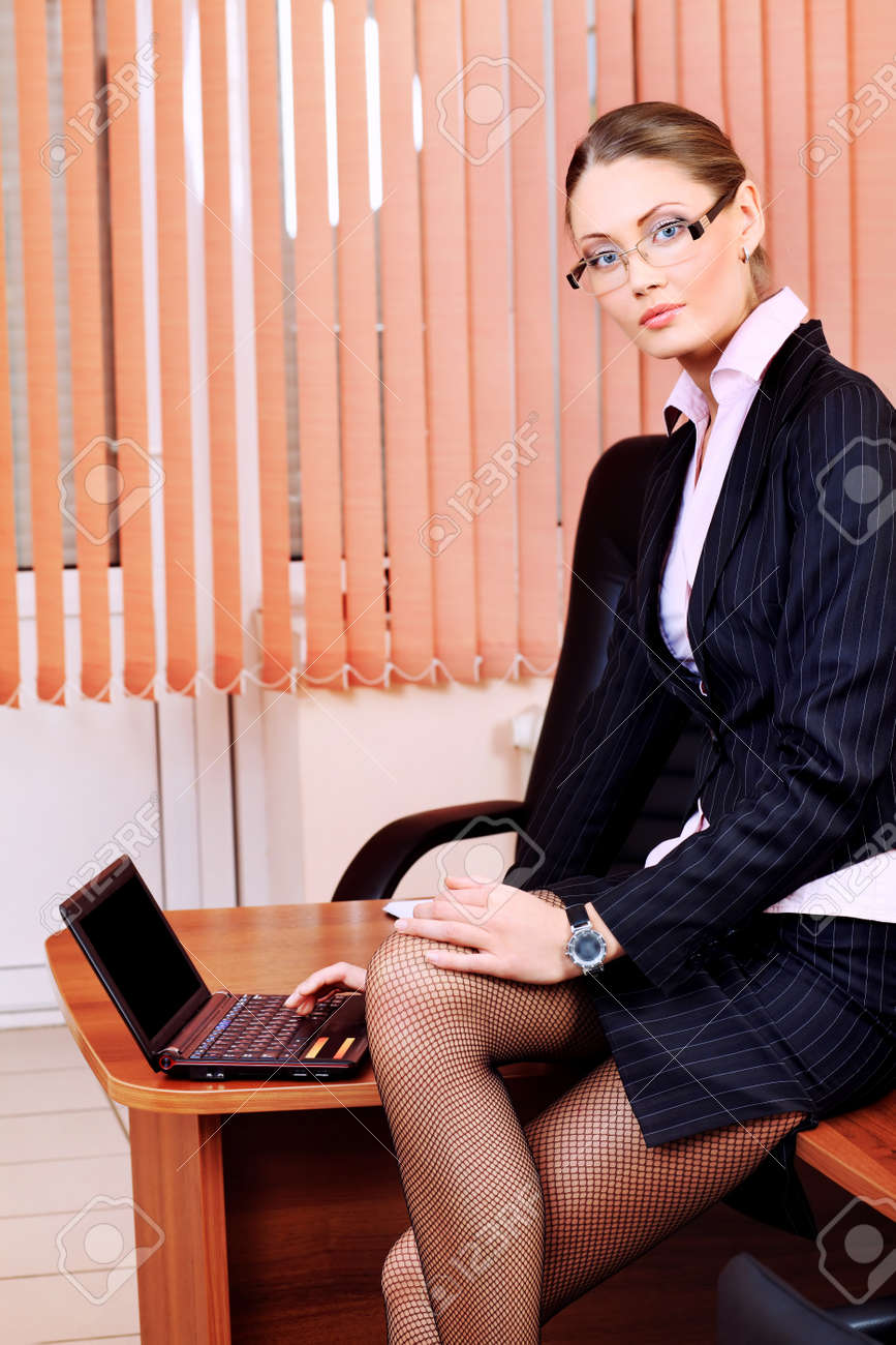 Beautiful business woman is working at the office. Stock Photo - 9686462
