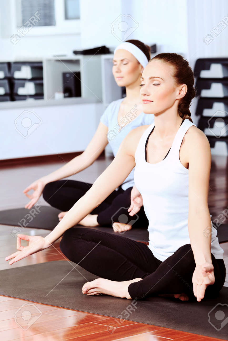 Group of young women in the gym centre. Yoga. Stock Photo - 9774852