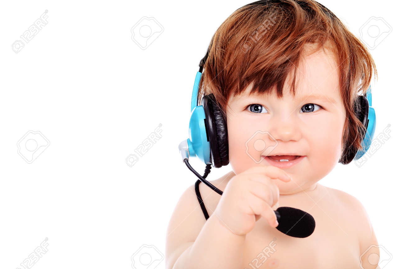 Adorable baby girl with headset microphone. Isolated over white. - 9785041