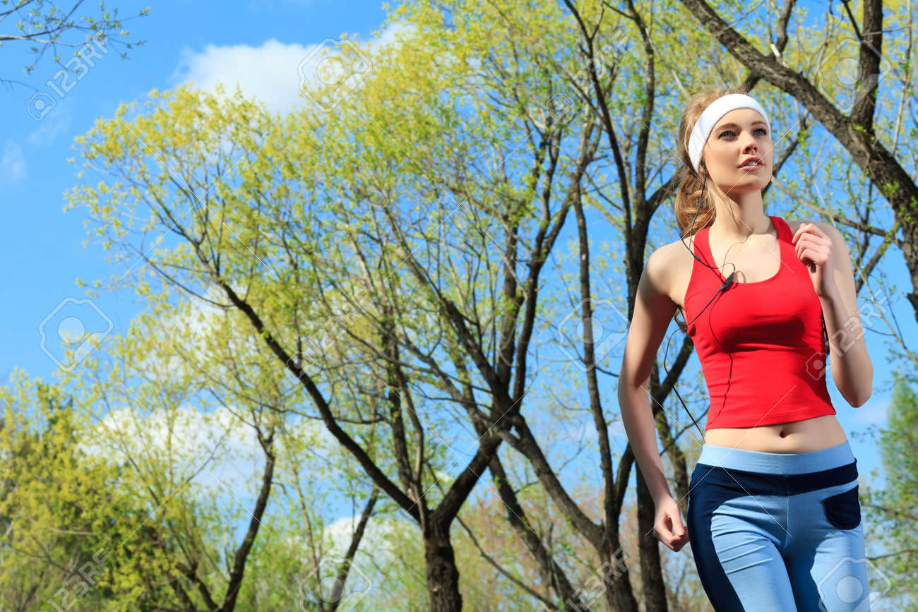 Young sporty woman is jogging outdoor. Stock Photo - 9837080
