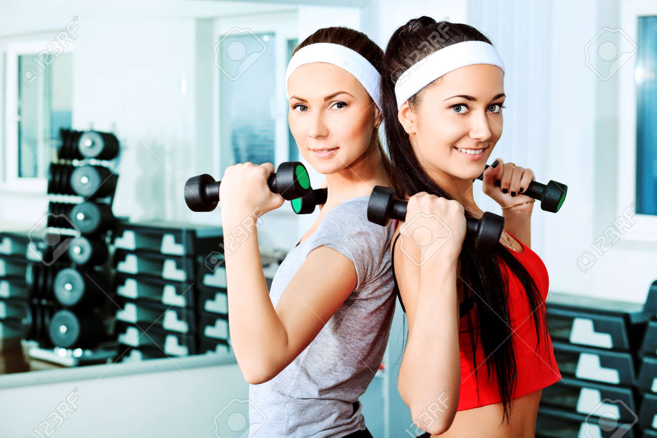 Two young sporty woman in the gym centre. Stock Photo - 9997431