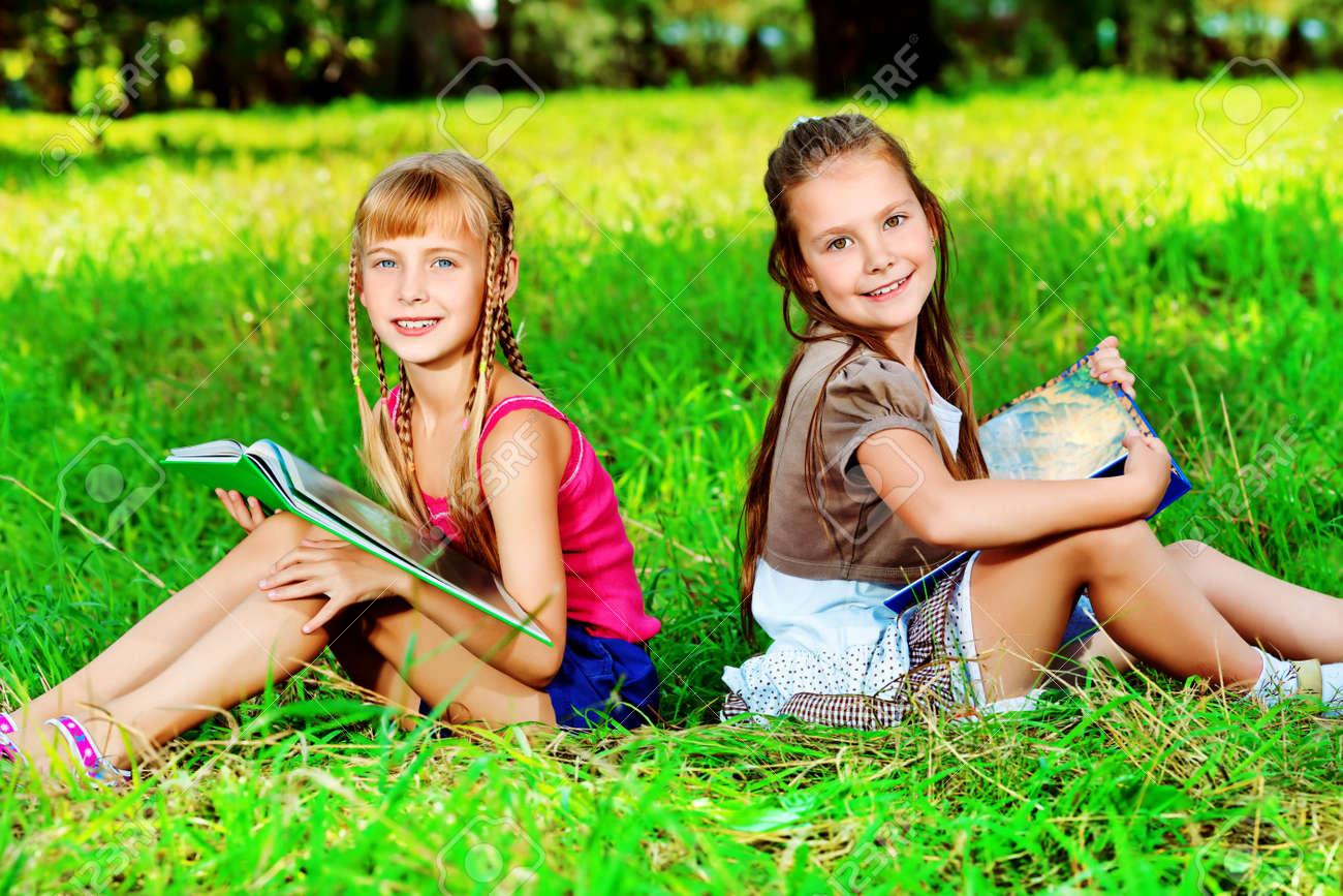Two cheerful girls having fun outdoors. Stock Photo - 10133015