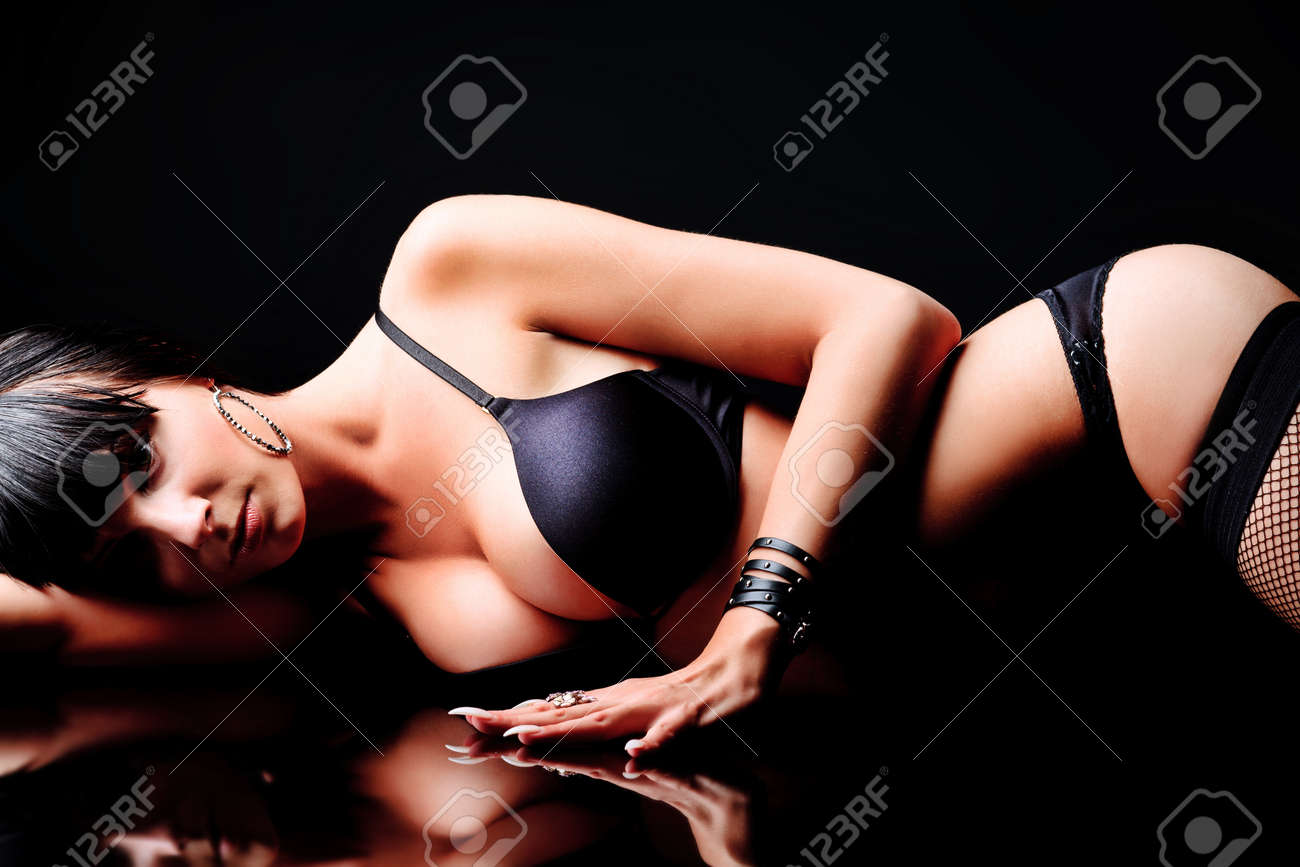 Shot of a sexy woman in black lingerie over black background. Stock Photo - 10132991